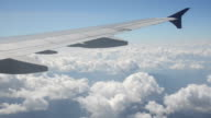 Flying over fluffy clouds