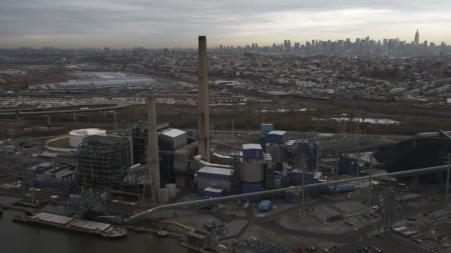 Flying over industrial area in Jersey City New Jersey; New York City skyline in background. Shot in November 2011.