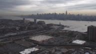 Flying over Jersey City, Midtown Manhattan skyline in background. Shot in 2011.