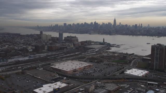 Flying over Jersey City, Midtown Manhattan skyline in background. Shot in 2011.