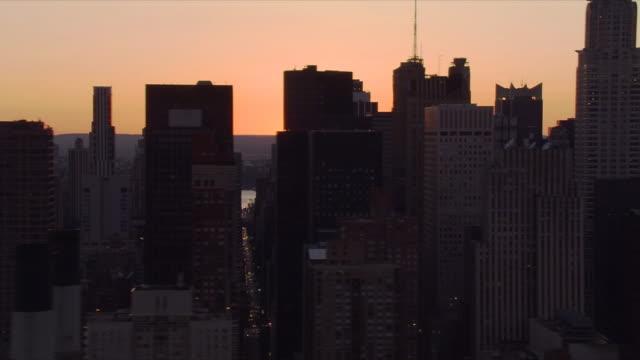 Flying over Manhattan at sunset. Shot in 2006.