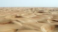 Flying Over Sand Dunes In Desert