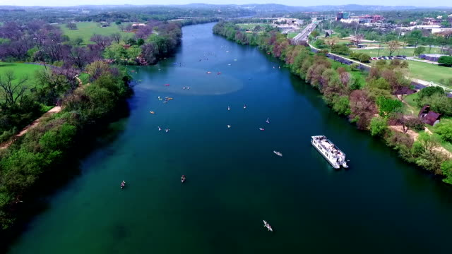 Flying over the Middle of Lake Aerial View Austin Texas Colorado River Fun Spring water activities with kayakers and Party Boat during SXSW Spring Break 2016