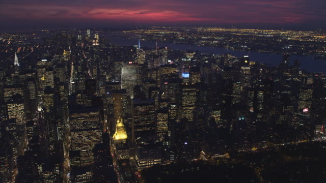 Flying over Upper Manhattan at dusk with Central Park in foreground; looking down 7th Street to Times Square, Columbus Circle at right and Hudson River in background. Shot in 2011.