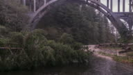 Flying under Cape Creek Bridge along the river