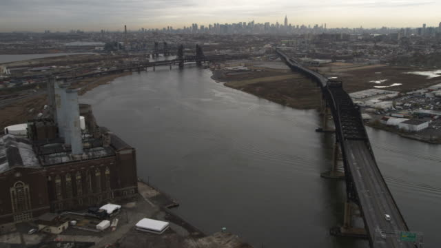 Flying up the Hudson River over an industrial area between the Pulaski Skyway and the Newark Turnpike in Jersey City, New Jersey. Shot in November 2011.