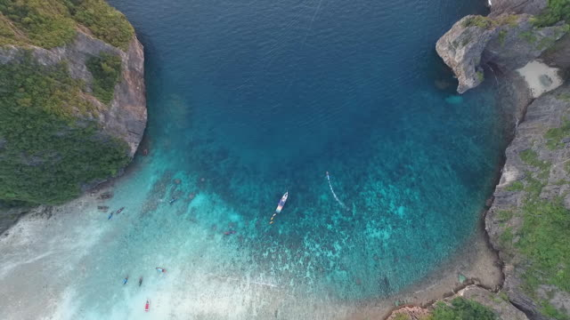 flying upwards above the Maya Bay with boats