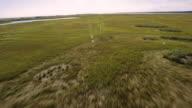 Flyover of beach/sand dune marsh area