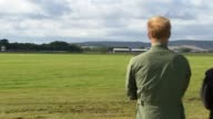 WWII Flypast marks 75th anniversary of Battle of Britain Prince Harry watches aircraft Various of Prince Harry and others watching aircraft /...