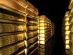 Fly-through past stacks of gold bullion bars