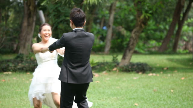 Focus in: Happy Bride and groom at Wedding Dance