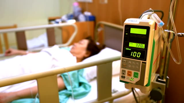 Focus in: Hospital Patient with Saline Solution Volumetric Infusion Pump