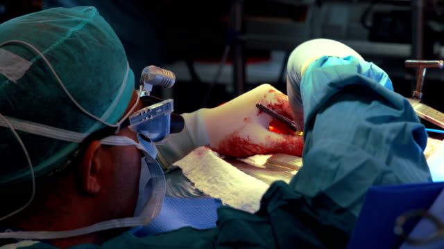 Focused surgeon operates a patient