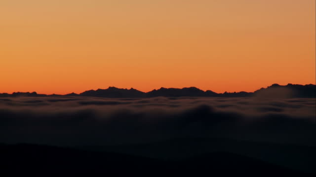 fog at dawn in front of swiss alps