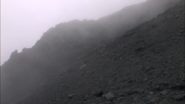 Fog Flowing At The Mountain Foot