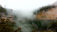 Fog over mountain and Waterfall in Blue Mountain Australia