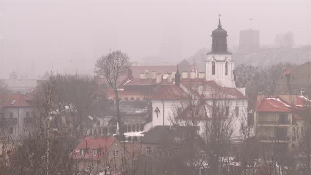 Fog settles over a Siauliai neighborhood on a winter day. Available in HD.