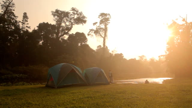 fog sunrise on the river with camping