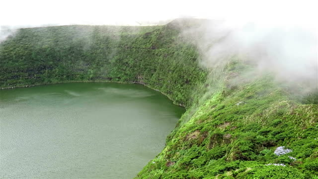 Foggy crater lake Lagoa Funda / Caldeira Funda, Flores Island, Azores