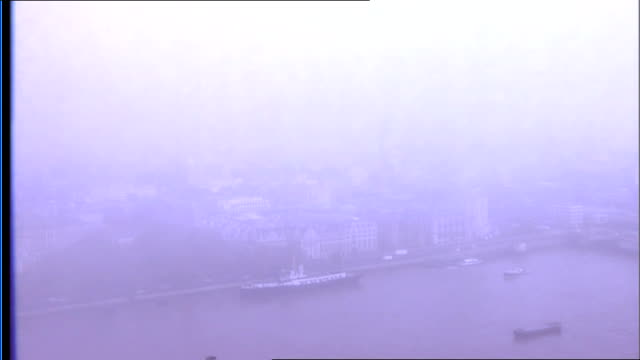 Foggy River Thames at South Bank ENGLAND London South Bank / Southbank EXT Various high angle general views of River Thames from rooftop of building...