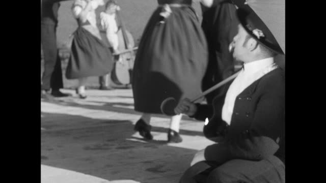 MONTAGE Folk dancers with musicians playing wind and stringed instruments / Switzerland