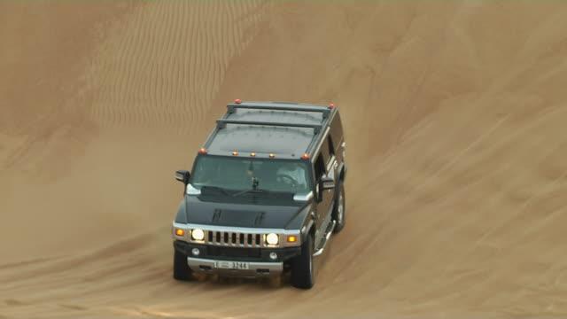 Follow Shot Of Car In Desert Dubai United Arab Emirates