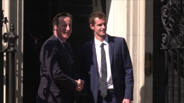 Following his Wimbledon triumph British tennis player Andy Murray was invited to 10 Downing Street on Monday where he was greeted by British Prime...