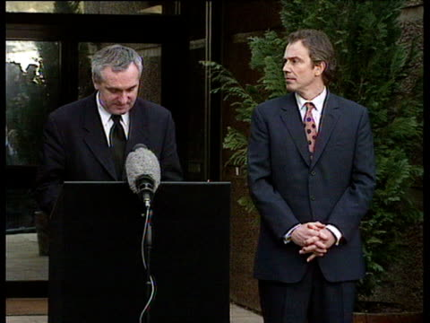 Following talks on Good Friday Agreement Irish Prime Minister Bertie Ahern stands next to Tony Blair making speech to press outlining his hopes for