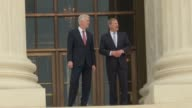 Following the formal investiture ceremony US Supreme Court Chief Justice Roberts escorts newly minted Justice Neil Gorsuch out and down the steps of...