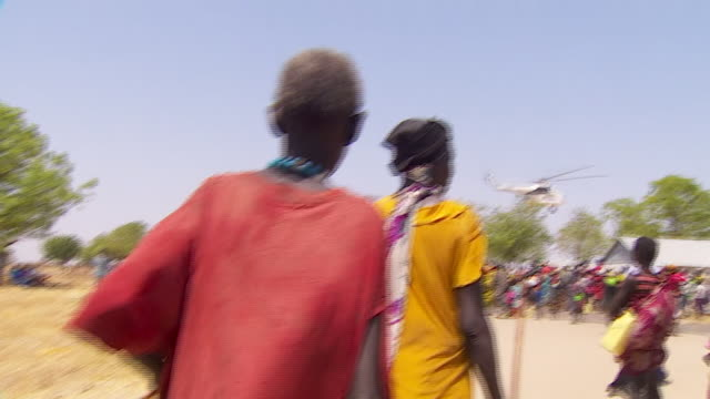 Food and water aid arriving by helicopter in South Sudan