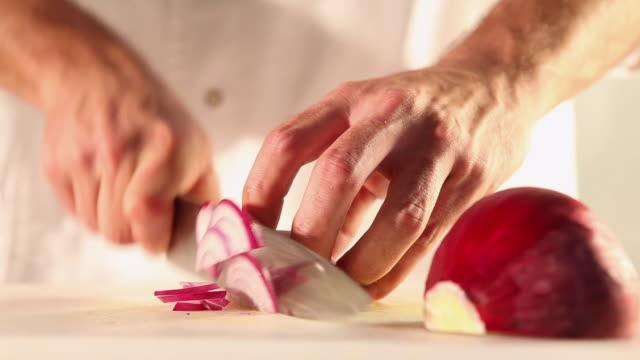MS Food chef chopping red onion / Sao Paulo, Brazil
