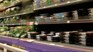 growth in sales of superfoods ENGLAND Central London Sainsbury's INT Packs of salad leaves on display in supermarket Vox pops shoppers SOT Back View...