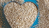 Food ingredients for healthy eating:  close up of quinoa grains in heart shape