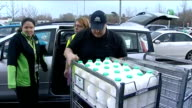 Food provisions by boat in Somerset during floods ENGLAND Somerset EXT People loading up boat and cars with food and other domestic provisions in...