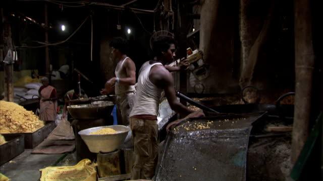 Food service workers prepare massive quantities of food.
