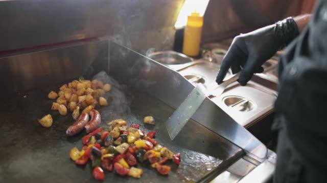 Food Truck owner cooking fresh food