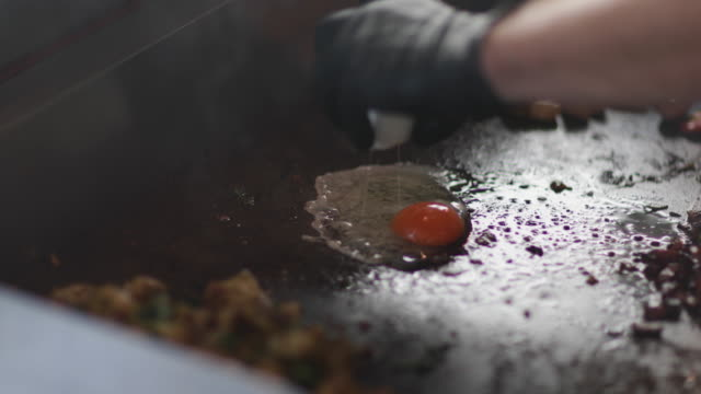 Food Truck owner frying an egg