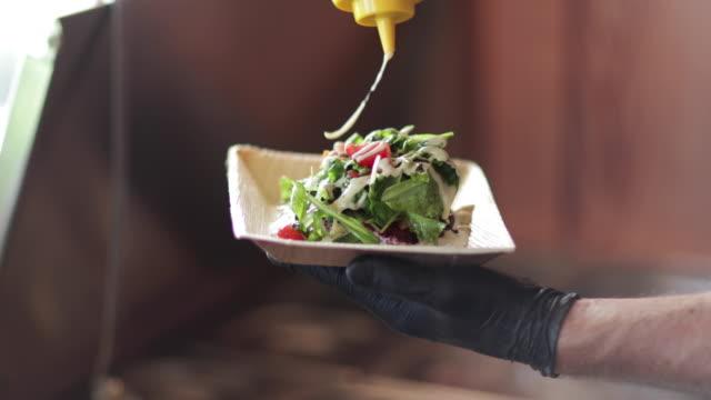 Food Truck owner preparing a salad