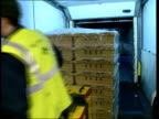 Dartmoor/Latest situation ITN Crates containing meat Man examining meat in crates TILT DOWN Man using small fork lift truck to move crates of meat...