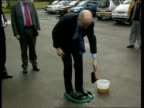 Vaccination talks ITN Cumbria William Hague MP cleaning his shoes with disinfectant during visit ZOOM William Hague MP interview SOT there is a need...