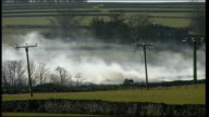 General views of farm burning animal pyre SCOTLAND Lockerbie EXT General views of farm burning animal pyre / sign on gatepost 'Keep Out Foot Mouth' /...