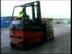 Movement of livestock SCOTLAND Glasgow EXT Forklift carrying crates of meat along in Asda supermarket loading area PAN Butcher sorting thru bags of...