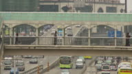 Foot bridge with city traffic in Guangzhou China