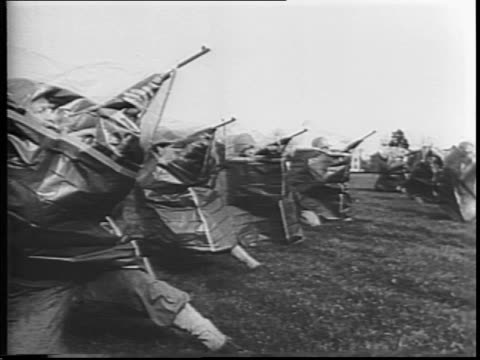 US foot soldiers practice drills with antigas hoods and antigas masks at Camp Santini / soldiers puts on antigas hoods and crouches down / two lines...