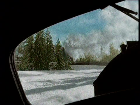 Footage from aboard the train traveling through the snow / Stopped at Donner Summit / Aerial Footage of the stranded train /