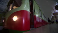 Footage from the North Korean metro system showing a train departing the platform and passengers in a carriage