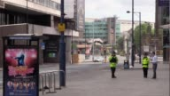 Footage from the scene the morning after the terror attack at the Manchester Arena where police have set up a cordon Includes shots of police...