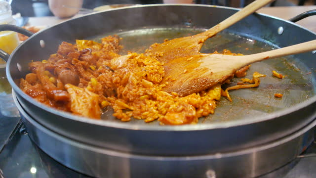 4K footage : Korean Cuisine , Dak Galbi , Fried rice with chicken and seafood sauce