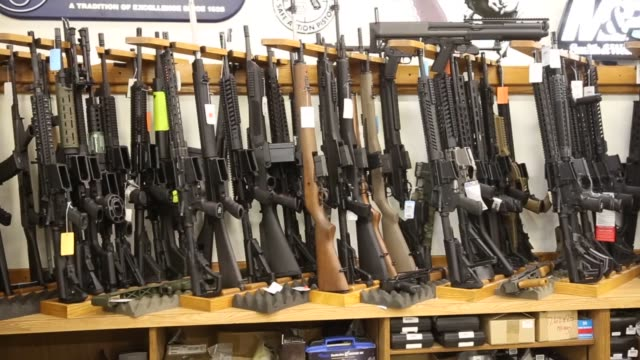 Footage of a gun store that sells all types of guns and rifles in Orem Utah on August 12 2016 Shots pan right of interior of gun store pan left of...