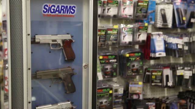 Footage of a gun store that sells all types of guns and rifles in Orem Utah on August 12 2016 Shots pan right of many pieces of ammunition more...